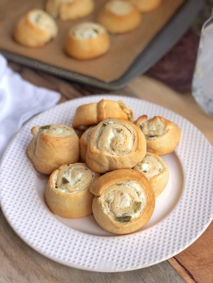 Jalapeño Cream Cheese Pinwheels Recipe - Quick and easy appetizers for a party! A sweet and spicy snack idea everyone will love. Made with just 4 simple ingredients! The Lazy Dish #thelazydish #gameday #appetizers #pinwheels #funsnacks #lazyfood
