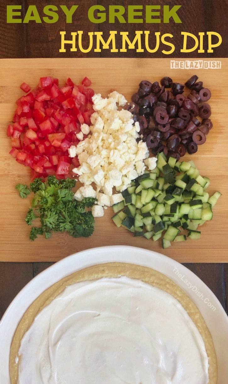 7 Layer Greek Dip Appetizer   Looking for quick and easy cold appetizers for a crowd? This simple dip recipe can be made ahead, and is always a hit! It's perfect for a party or snack. Serve it with pita chips as an easy finger food! The Lazy Dish #thelazydish #lazyfood