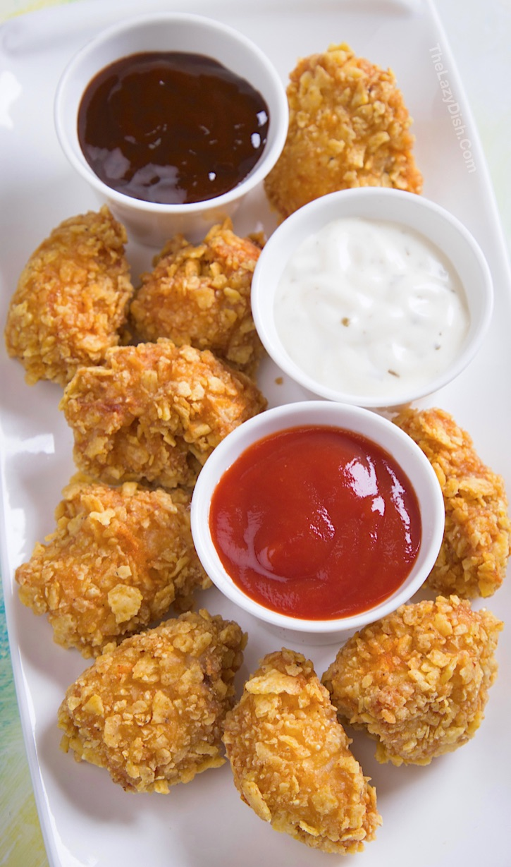 Baked Chicken Nuggets made with butter, eggs and Ritz crackers. Delish! A quick and easy boneless chicken dinner recipe the entire family will love!