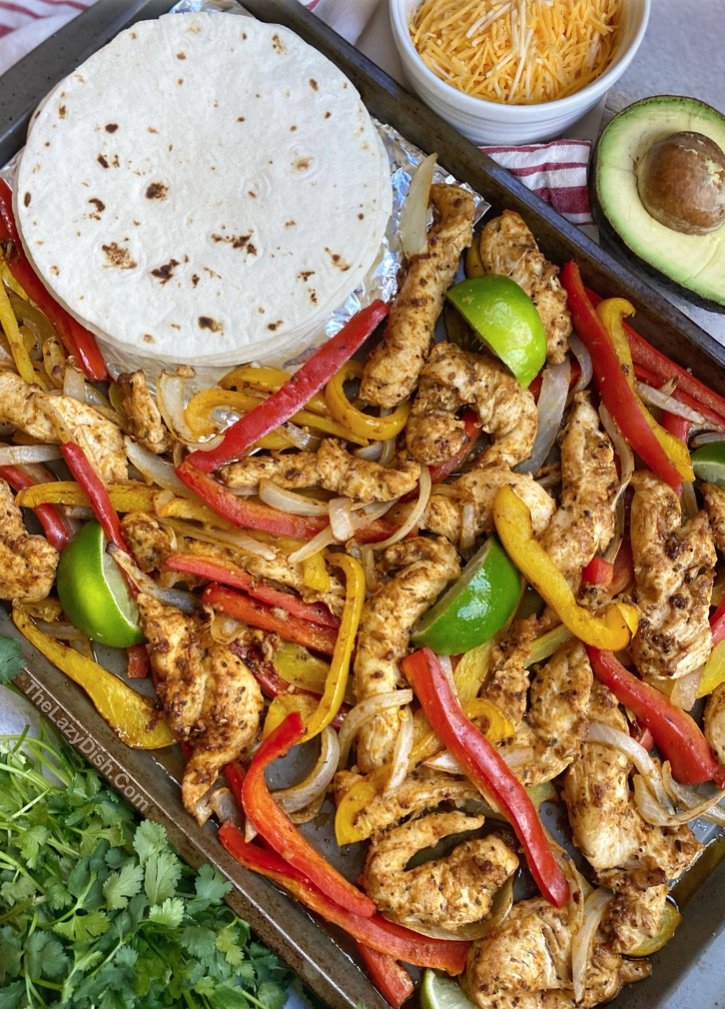 Easy oven baked chicken fajitas made on a sheet pan! A family favorite dinner recipe.